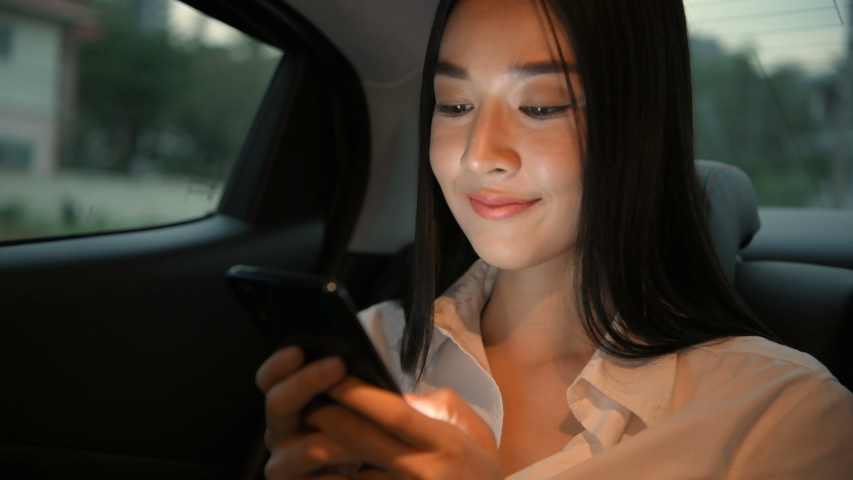 Travel concept. Asian women sitting on mobile phones in cars. 4k Resolution. Royalty-Free Stock Footage #1055019944