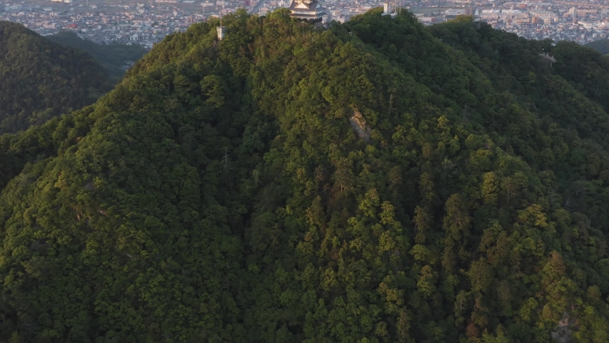 Gifu castle on Mt Kinka, Slow Aerial reveal ancient building and Japanese city