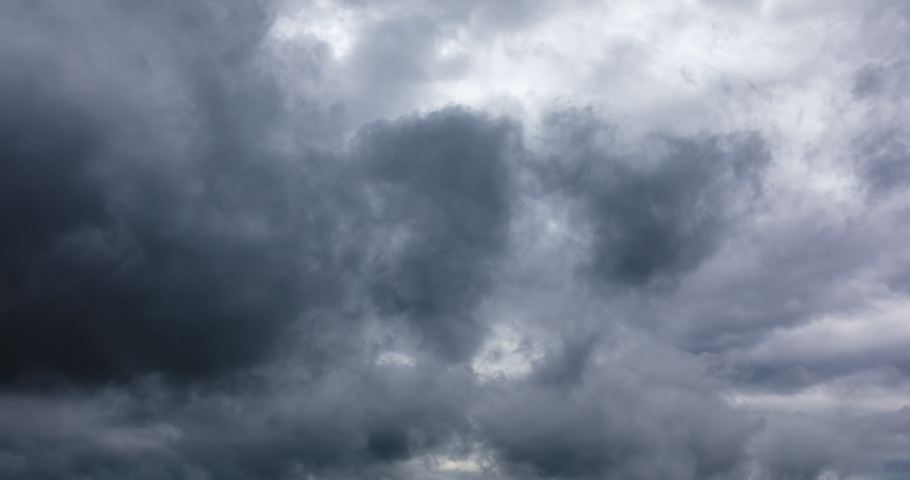 The fast moving black clouds in the sky before the rainstorm,Dark clouds are rolling,dramatic sky.4k time lapse. | Shutterstock HD Video #1055056577