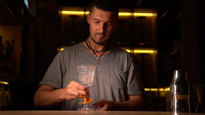 Handsome barman gives alcohol cocktail french 75 to you in the bar. Advert for night club, bar, pub. | Shutterstock HD Video #1055064884