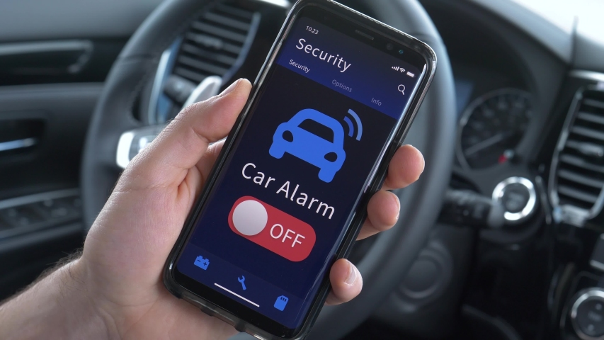Using a smartphone to turn ON the car alarm security feature.