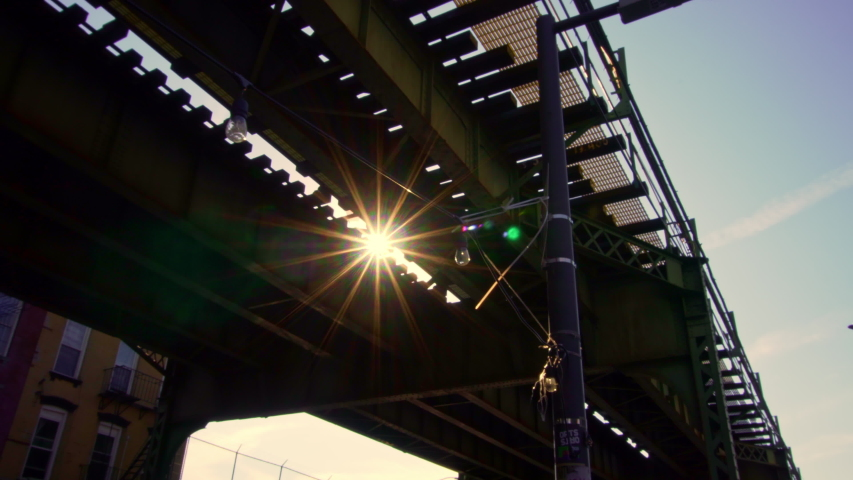 New York City camera moving under Train tracks with Sunlight and Flares. Cinematic feel. | Shutterstock HD Video #1055076758