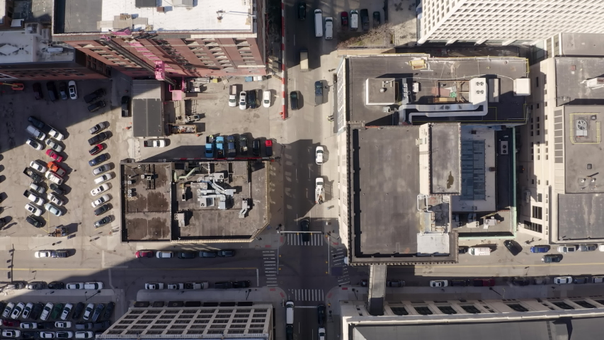 Straight Down Aerial Lowering Over Streets Tracking Traffic