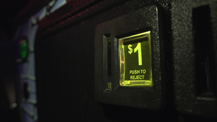 Dollar coin inserted into Canadian pinball machine 4k