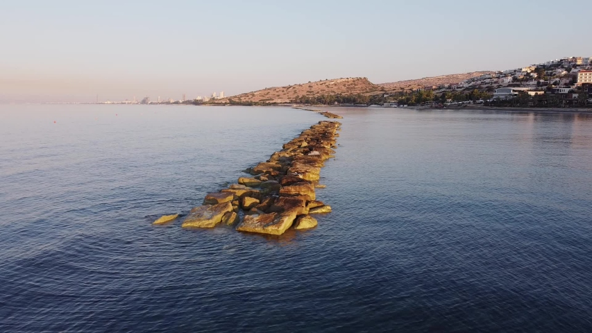 The beaches of Cyprus.  Span of a drone along a breakwater.  Early morning.