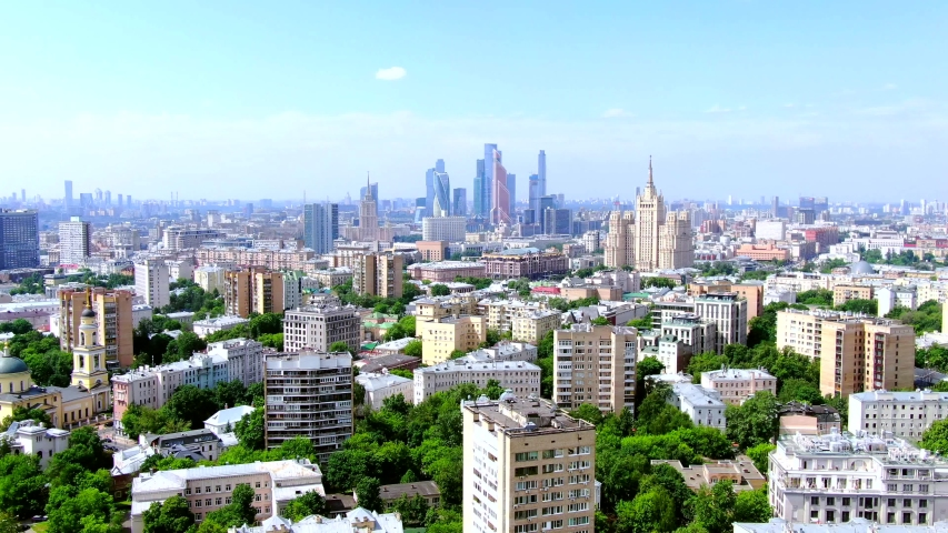 Moscow, Russia. Aerial panoramic view of the downtown, soviet high-rise buildings and Moscow city skyscrapers Drone flying over the amazing cityscape. Was filmed at summer day   Shutterstock HD Video #1055091431