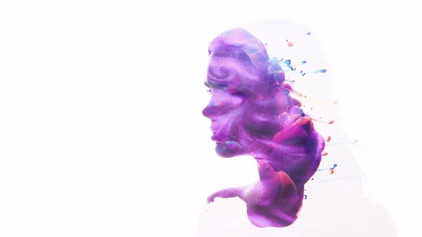 Art portrait. Inner beauty. Purple blue ink swirl in female head silhouette double exposition isolated on white.