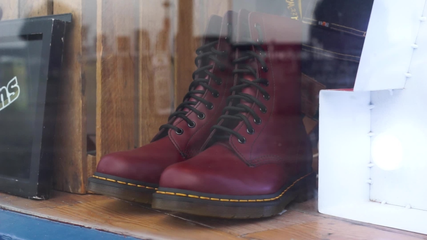 Red Leather Boots in a Storefront | Shutterstock HD Video #1055102738