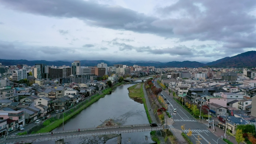 Aerial view 4k video by drone of Kyoto buildings with skyline view in Kyoto city, Japan. evening | Shutterstock HD Video #1055103299