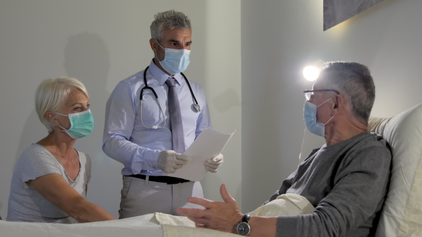 doctor visiting old senior man with coronavirus covid-19 disease at home give an elbow bump greeting,caregiver medic talking with an elderly man giving consultation and health ckeckup Royalty-Free Stock Footage #1055105879