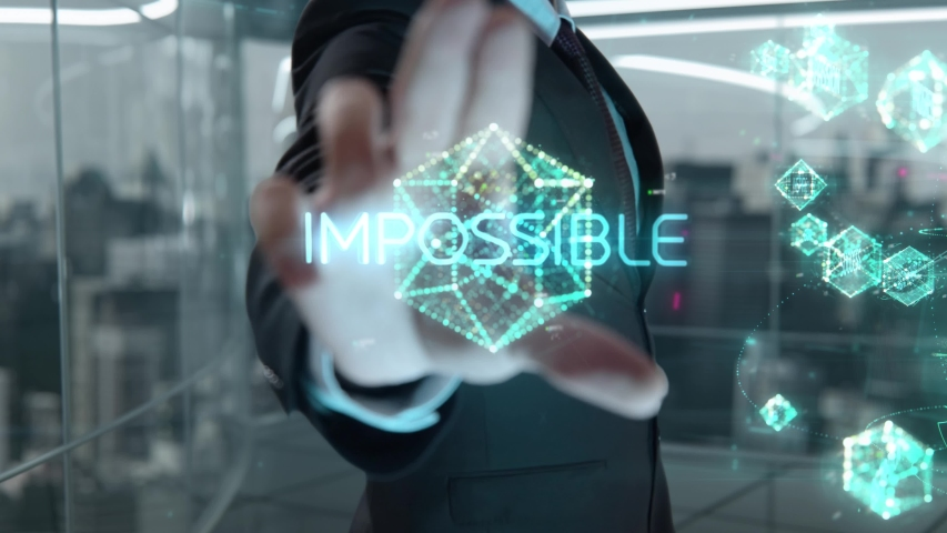 Businessman with Impossible hologram concept | Shutterstock HD Video #1055107919