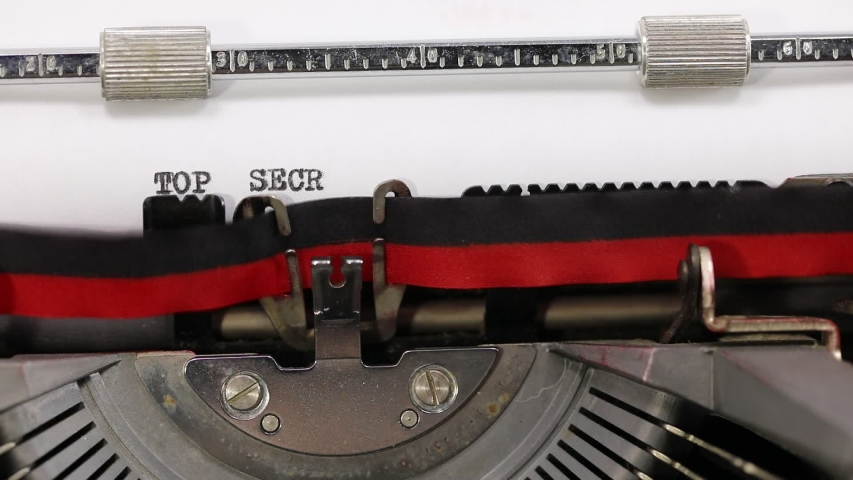 Writing on the vintage typewriter the text TOP SECRET on the white sheet | Shutterstock HD Video #1055118185