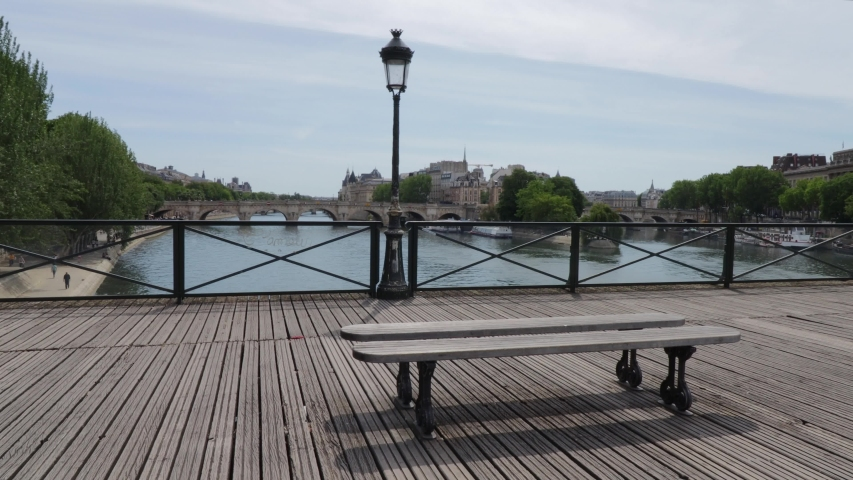 Pont des Arts bridge empty with nobody during corona virus crisis, wide panning shot during summer day in Paris France   Shutterstock HD Video #1055125049