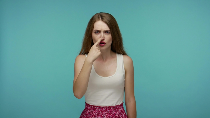 You lie! Angry girl in dress touching nose and pointing finger to camera, showing liar gesture, blaming deception, suspecting cheats, fake story and falsehood. studio shot isolated on blue background | Shutterstock HD Video #1055127596