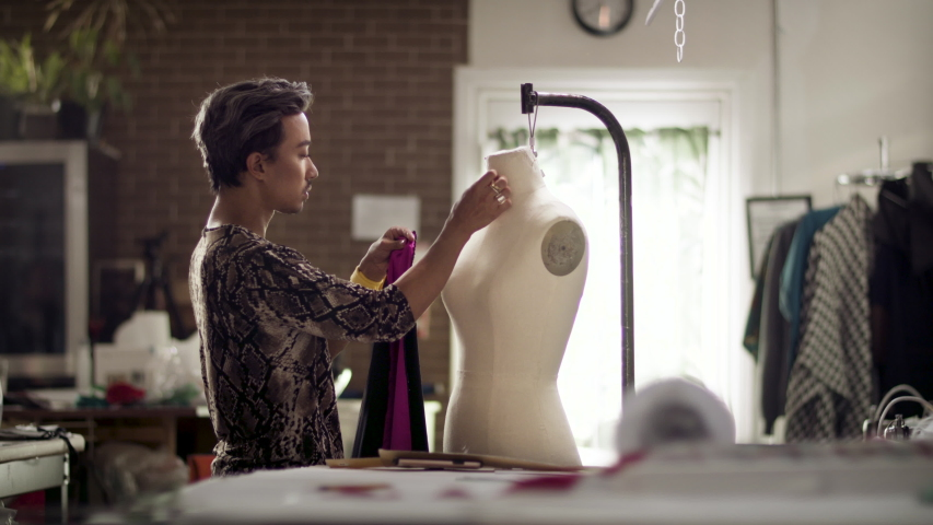 Fashion Designer draping a mannequin. Small business creative at work. Diversity and authentic artisan. Shot in 4k and in slow-motion.