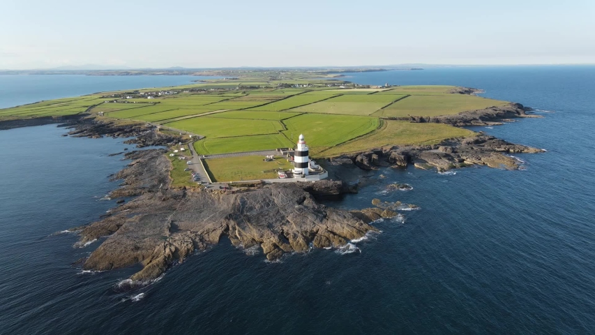 Ariel view of Hook Lighthouse situated on Hook Head at the tip of the Hook Peninsula in County Wexford, Ireland. | Shutterstock HD Video #1055129183