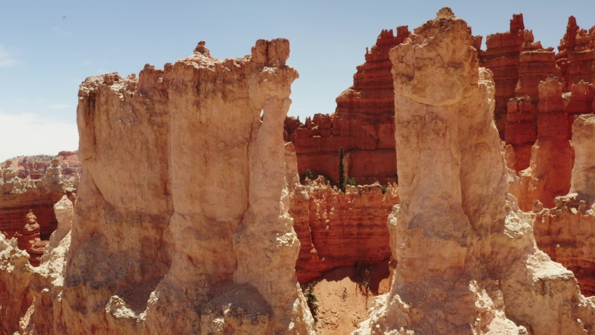 Cinematic aerial of Bryce Canyon National Park, red rocky spires, natural phenomena, landscape of another planet, scenic Utah