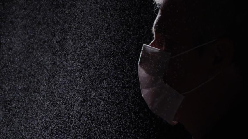 Man wearing mask in a toxic enviroment | Shutterstock HD Video #1055134667