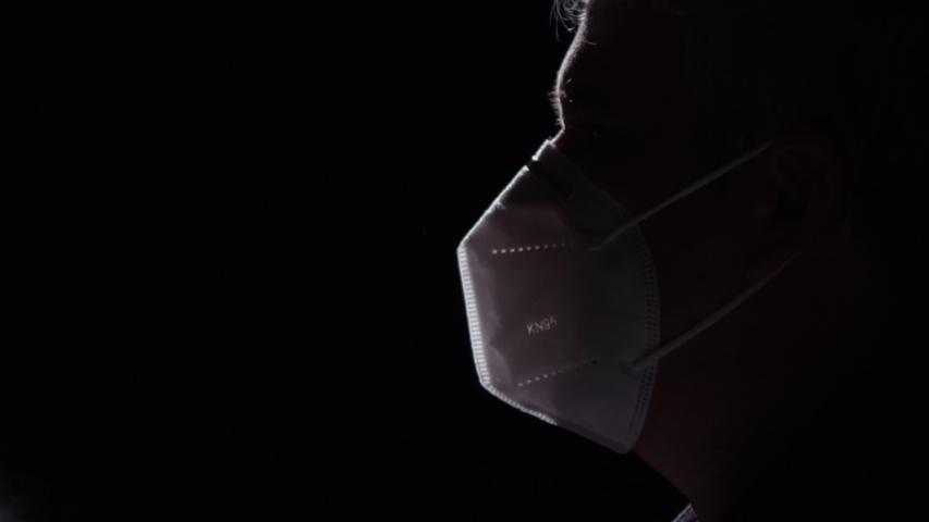 Man wearing mask in a toxic enviroment | Shutterstock HD Video #1055134670