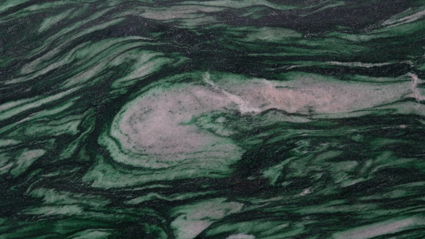 Polished Surface Of Guatemala Green Marble With White Swirls And Curves Design For Background. - panning shot