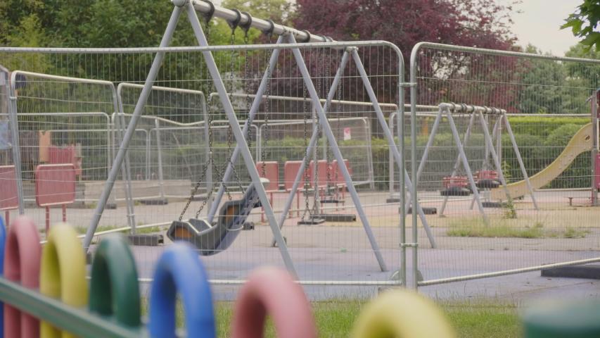 Focus pull of Playground Closed due to Coronavirus Lockdown.  Royalty-Free Stock Footage #1055159861