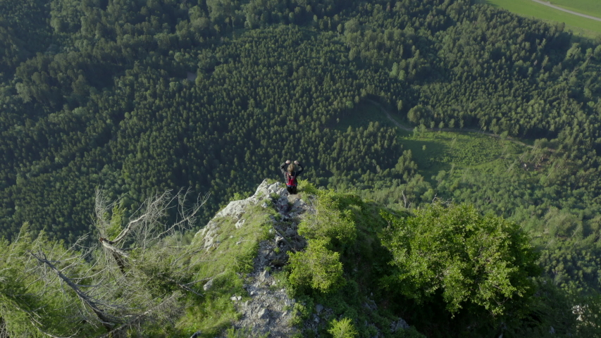 Aerial view from man BASE jumping from mountain in Austria