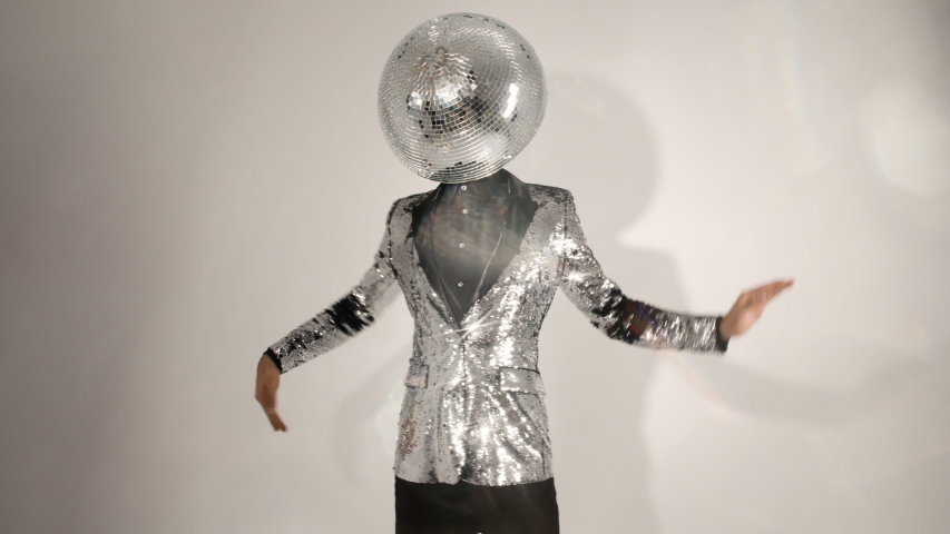 Mr discoball with a mirrorball as a head dancing in silver sparkly jacket with lens flare   Shutterstock HD Video #1055182154