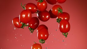 Super slow motion of falling tomatoes with water splashes. Filmed on high speed cinema camera, 1000fps