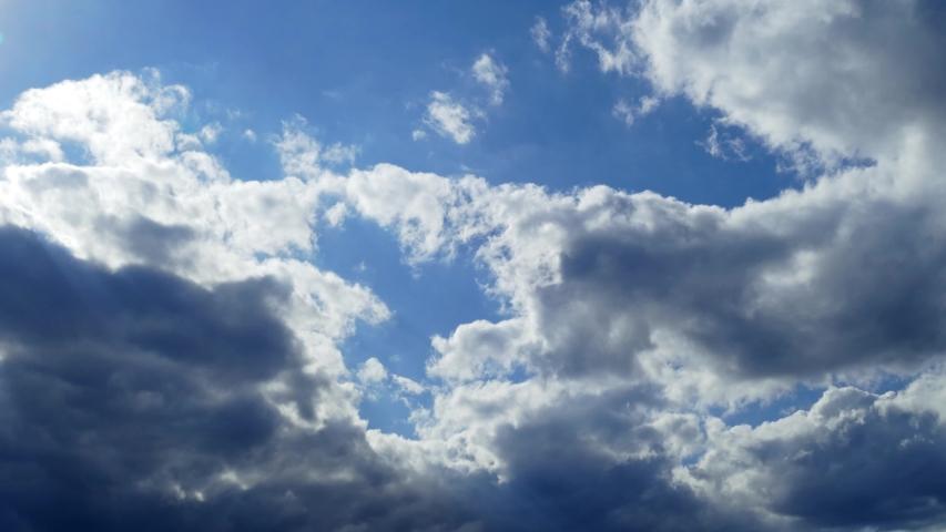 Dark clouds on blue sky timelapse   Shutterstock HD Video #1055189324