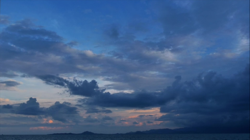 Time lapse of rain storm sky with clouds moving  above the seascape