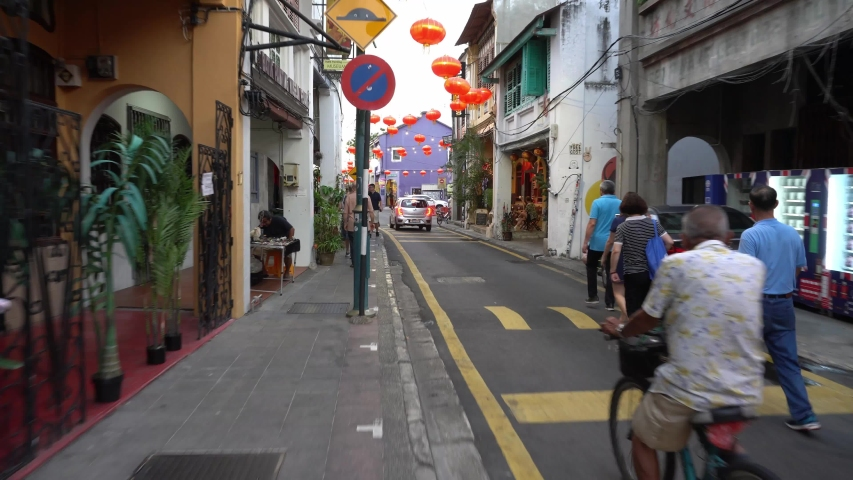 George Town, Penang / Malaysia - Jan 22 2020: Local cycling at street. Tourist walk at street.