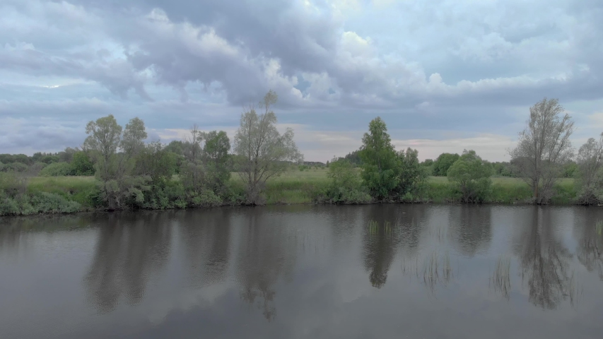 Sailing Along A River With Trees | Shutterstock HD Video #1055197850