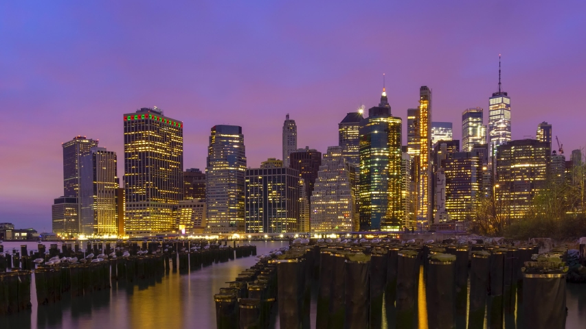 Beautiful sunrise over Manhattan office buildings at Lower Manhattan in the morning. New York City, Time lapse New York City skyline at sunrise,