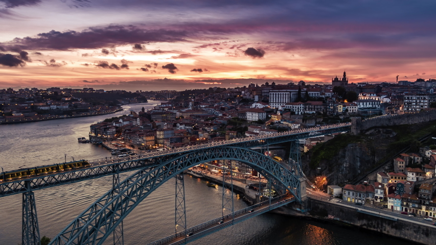 Stunning Sunset, Aerial View Shot of Porto, Oporto, Dom Luis I Bridge, Douro River, Old Town, Portugal Royalty-Free Stock Footage #1055208230
