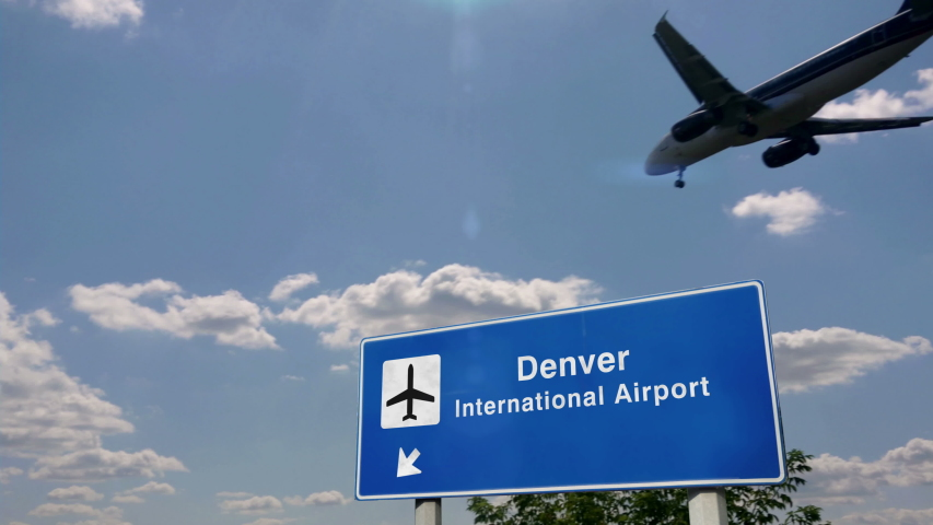 Jet airplane landing in Denver, Colorado, USA. City arrival with airport direction sign. Travel, business, tourism and transport concept. 3D rendering animation. | Shutterstock HD Video #1055208764