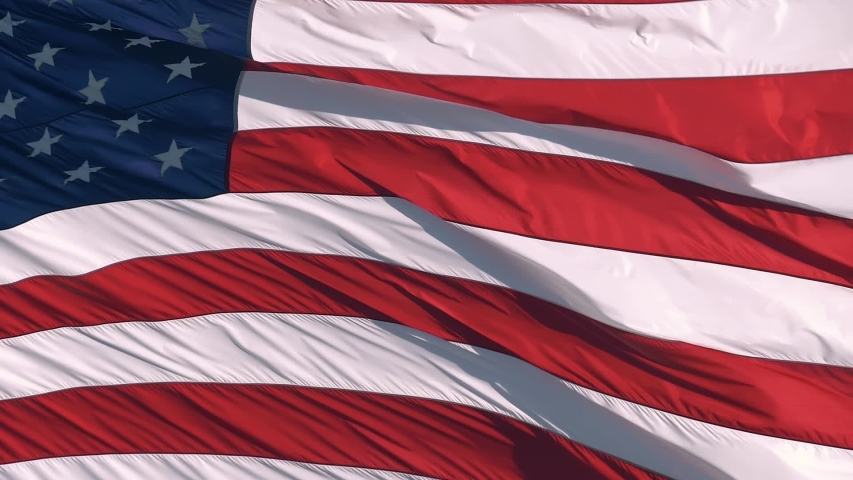 American flag USA Close Up waving background texture. Close up slow motion footage of USA flag waving in wind on a bright sunny day. Waved highly detailed fabric texture of American flag, slow motion. Royalty-Free Stock Footage #1055214461