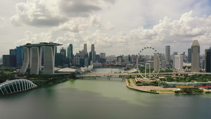 Drone Aerial view 4k Footage of Singapore City Skyline at Marina Bay Singapore | Shutterstock HD Video #1055215139
