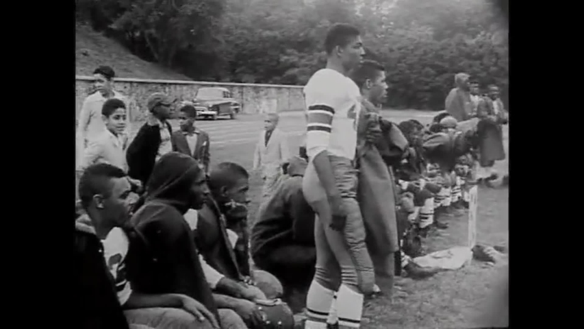 CIRCA 1956 - The Morgan State Bears play the North Carolina Wolfpack in a football game at the Morgan State College Stadium, and President Eisenhower throws out the first pitch in a baseball game