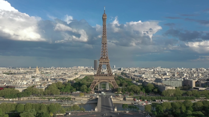 France Paris aerial drone shot flying over Trocadero looking at Tour Eiffel (Eiffel tower), cloudy. Cityscape backward view (looks like helicopter or drone shot).   Shutterstock HD Video #1055224706