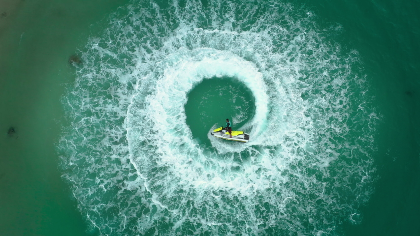 Vedio People are playing a jet ski in the sea. Aerial view and top view.amazing nature background.