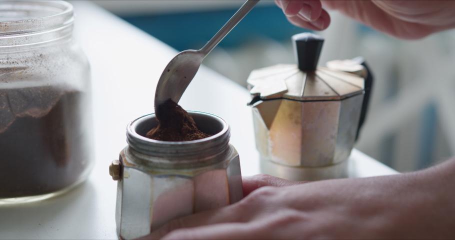 Woman prepares coffee in the Mocha coffee maker | Shutterstock HD Video #1055226020