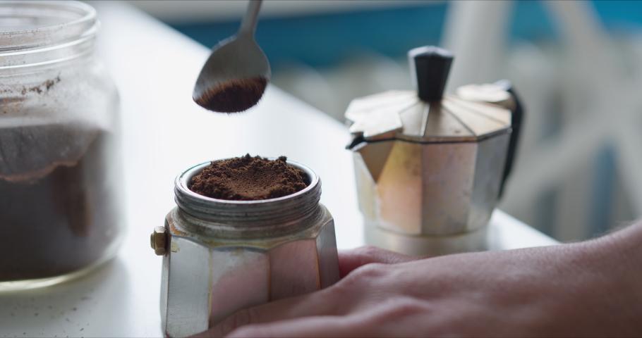 Woman prepares coffee in the Mocha coffee maker | Shutterstock HD Video #1055226047