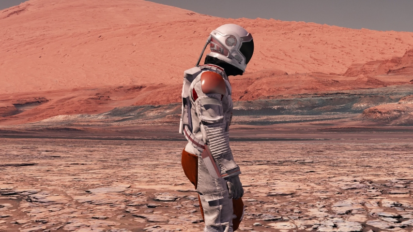 Astronaut wearing space suit walking on the surface of mars. Exploring mission to mars. Futuristic colonization and space exploration concept. 3d rendering. Elements of this video furnished by NASA. Royalty-Free Stock Footage #1055227931
