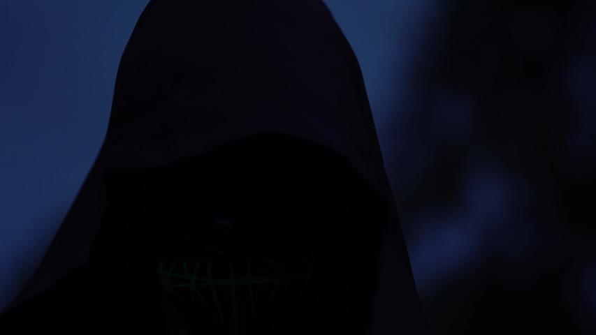 Mysterious Scary Cloaked Figure In Dark Halloween Horror Scene. | Shutterstock HD Video #1055239118
