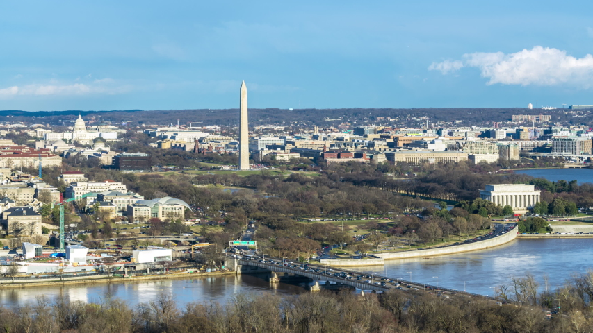 Time lapse aerial view of Washington, DC with the Jefferson Memorial, U.S. Capitol, Washington Monument, and Lincoln Memorial. Transportation and city lifestyle concept.