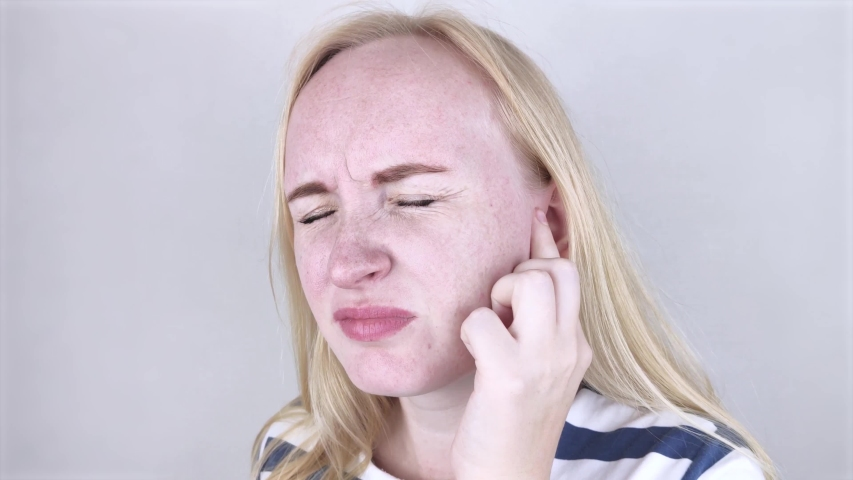 A woman suffers from pain in the ear. The auditory meatus hurts due to otitis media, cerumen plug, ear boil, or trigeminal neuralgia