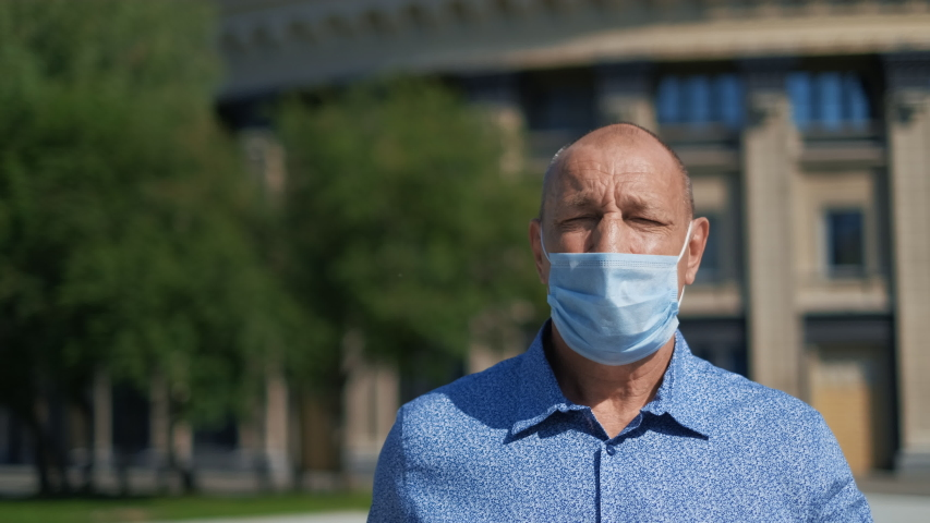 Real old age People Go Walk. Respiratory Mask. Older Senior Man. Pandemic Covid-19. Corona Virus Mers. Retirement pensioner. Elder Aged Human City. Epidemic Coronavirus. Masked olderly Face. Covid 19. | Shutterstock HD Video #1055245601