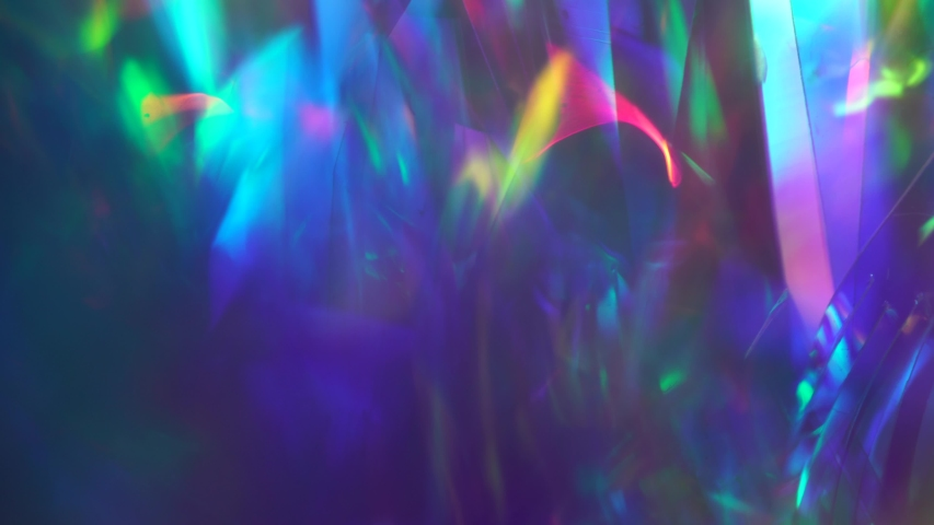 Crystal prism refracting light in vivid rainbow colors. Diamond neon purple holographic background