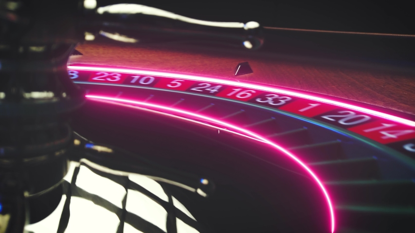 Roulette table close up at the Casino Neon light  track - Selective Focus Royalty-Free Stock Footage #1055248118