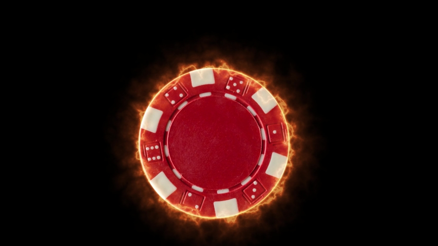 Red burning Casino chip over black background | Shutterstock HD Video #1055248121